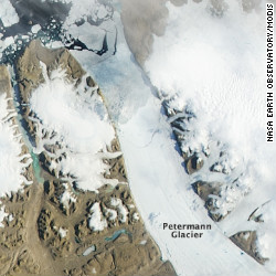 Massive ice island breaks off Greenland glacier